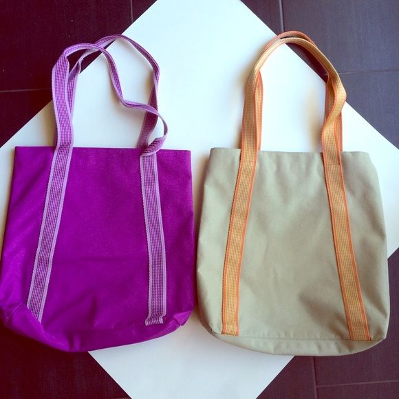 "*SALE!* Two GAP totes!! Seriously! Two GAP totes!  Identical, about 13"" by 13"", one is purple, the other like a greenish cream with orange straps.  Pretty, durable and practical!  Both for $25, or request individually please!  Greenish one has been gently used and washed ($14).  Purple one is brand new!! ($16).       Please consider BUNDLING for the best deal!  GAP Bags Totes"