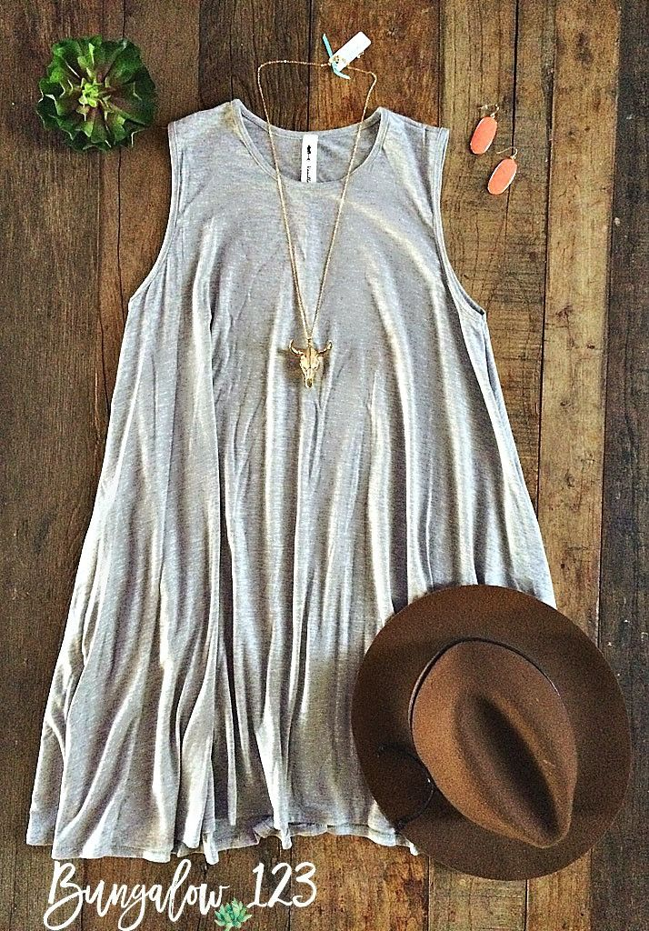Perfect casual dress in Heather Gray. Sleeveless with two side pockets. 95% Rayon 5% Spandex. A-line fit. Model is wearing a size small. Also available in Heather Black. Shown with Longhorn Necklace a