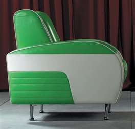 Green and white chair. Looks like it's made from a 50's or 60's vintage car