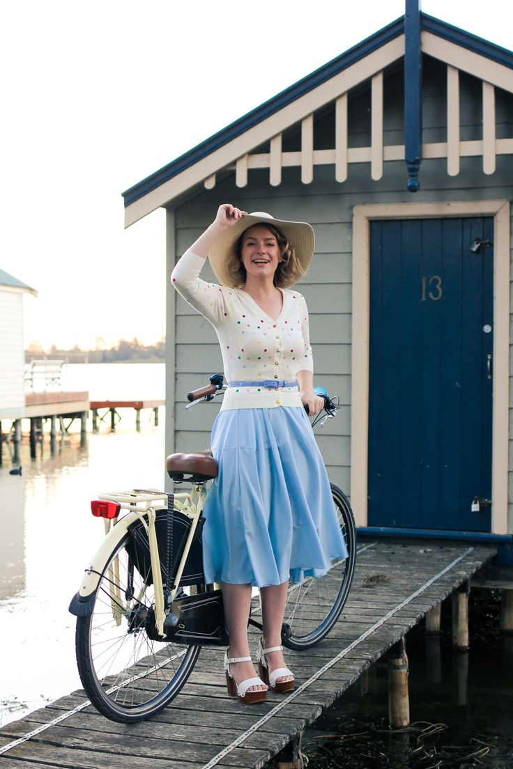 @findingfemme wears ice blue chicwish skirt with polka dot cardigan in cycle style.