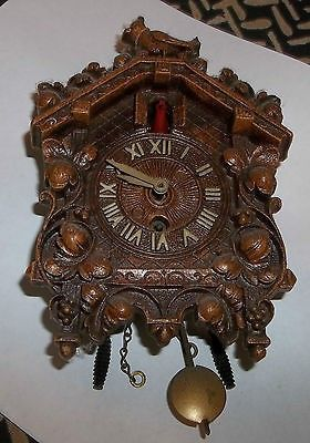 This listing features a delightful small coo coo clock with key. It was made by Lux of Waterbury Connecticut. I believe it is a composite like Syrocco. It measures 6 1/4  x 4 1/4 . It is dirty as has