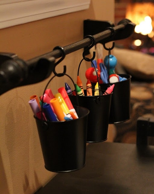 Cute way to organize kids coloring supplies.