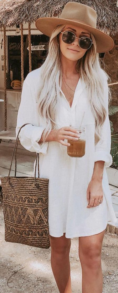 A classic white shirt dress to transition from spring to summer. The versatility and endless styling options makes a white short dress the ultimate vacation look. Style the gauzy lightweight fabric over a trendy swimsuit and wear as a swim cover-up. For a beachy boho vibe add a brown and black beach tote, gold sunglasses, and head to the water.