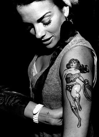 Wonder Woman tattoo, because deep down inside we know we don't have to be an Amazon to be a wonderful woman.  This will be the next tatt I get
