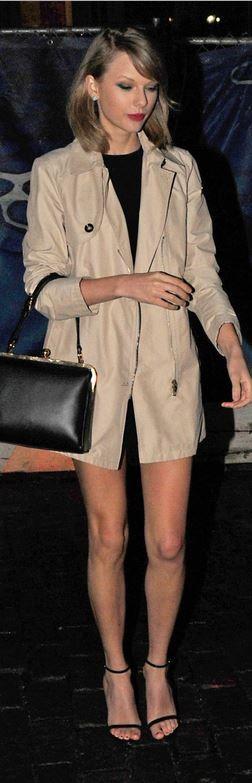 Taylor Swift: Purse – Dolce & Gabbana Coat – Armani Jeans
