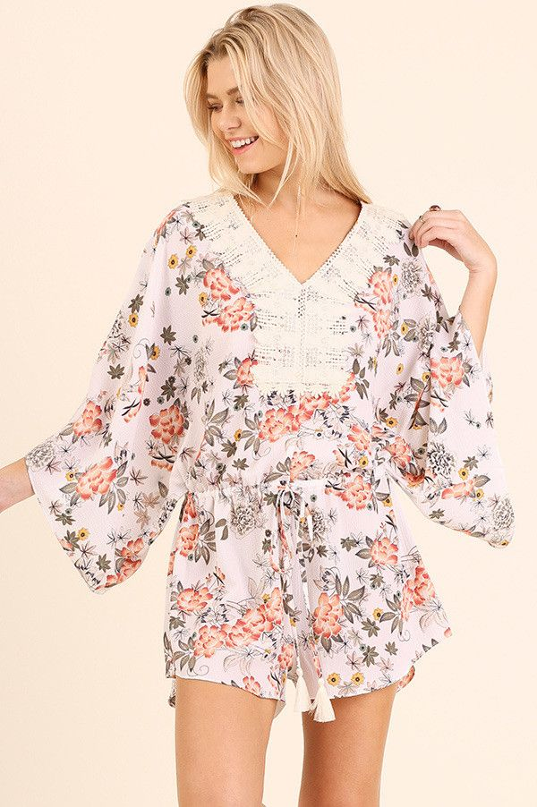 A delicate floral print complimented with a crochet neckline keeps this romper cute and classy! Turn around to reveal the low v-back cut out with a tie back detail. Short kimono sleeves. Drawstring wa