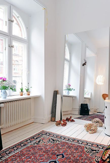 White wooden floors & a classic Persian rug.