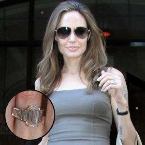 Angelina Jolie's three stone baguette accented engagement ring  #engagement #engagementrings #jewelry #artdeco #weddings #angelinajolie #brangelina #celebrity
