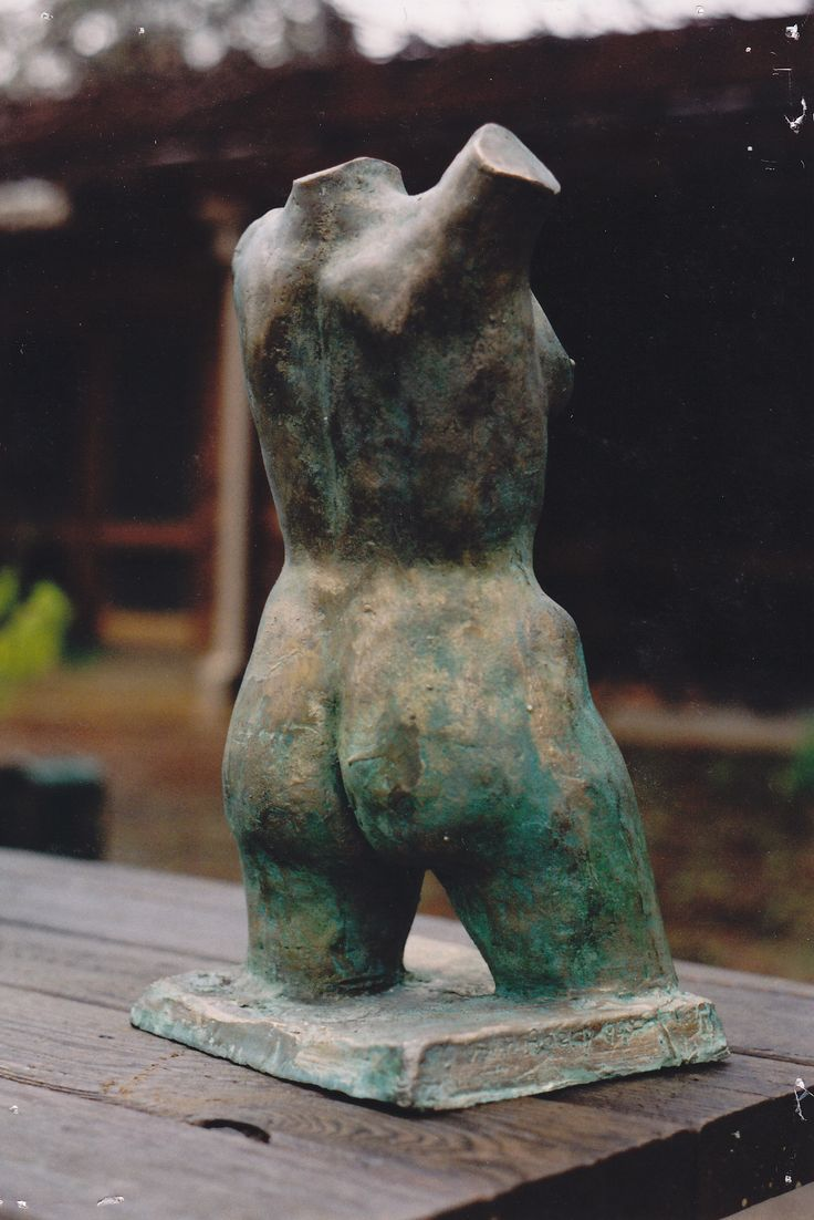 Bronze female torso sculpture