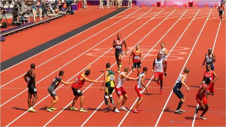 A view of the second to third change over during the Men's 4 x 400m Relay Round 1 heats taking place at the Olympic Stadium