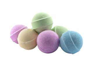 Bath bombs require only a few ingredients. You can add custom scents and oils to make a soothing bath even more enjoyable. Some of the ingredients, such as baking soda and food coloring, may already be in your kitchen, but you might need to go shopping for others, such as citric acid and essential oils.