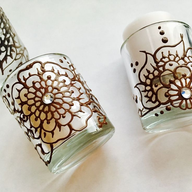 Last 12 votive candles in reusable glass holders hand painted with unique henna designs!! Super cute for gifts, favors, decor... Hurry up before they go out if stock!!! ❤🎈
