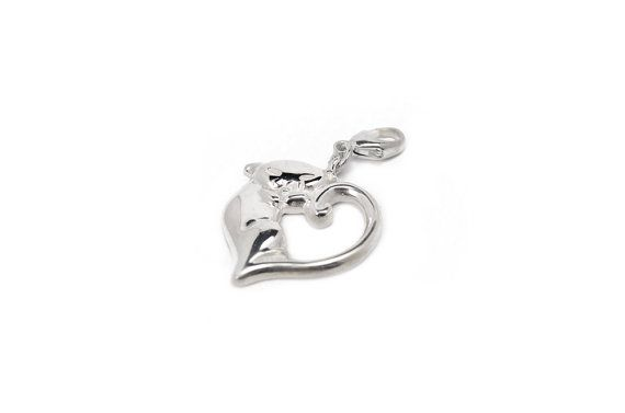 Lovely handmade silver charm in form of a heart shaped cat, with a carbiner. Fits perfectly alone or along with other charms on our heart bracelet that you can find in the shop as well. See the example picture!  Size: ~22 x 22 mm   Part of the income goes directly to selected shelters for homeless cats.