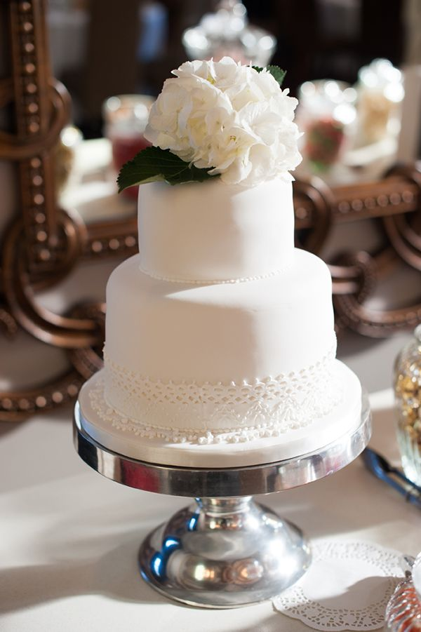 white wedding cake by Sherral Ross, see more here http://www.weddingchicks.com/2013/08/30/modern-chic-wedding/