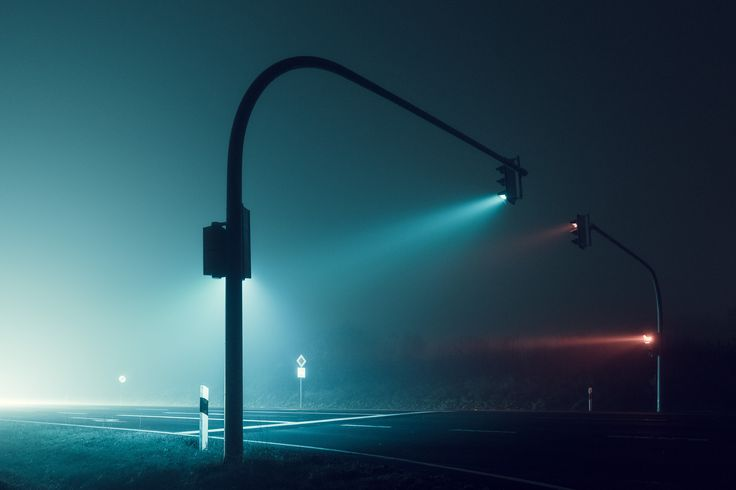 Roaming the city in dense fog, alone at night.