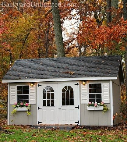 10'x16' Garden Shed with 11-Lite Fiberglass Doors, Flower Boxes, and Vinyl Shutters http://www.backyardunlimited.com/sheds.php