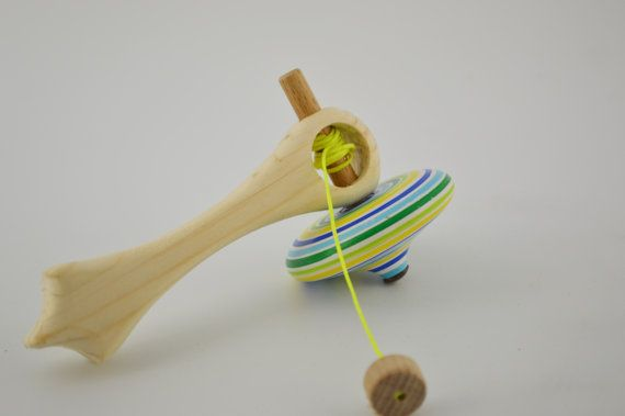 Wooden spinning top with handle by CraftsAndMetal on Etsy