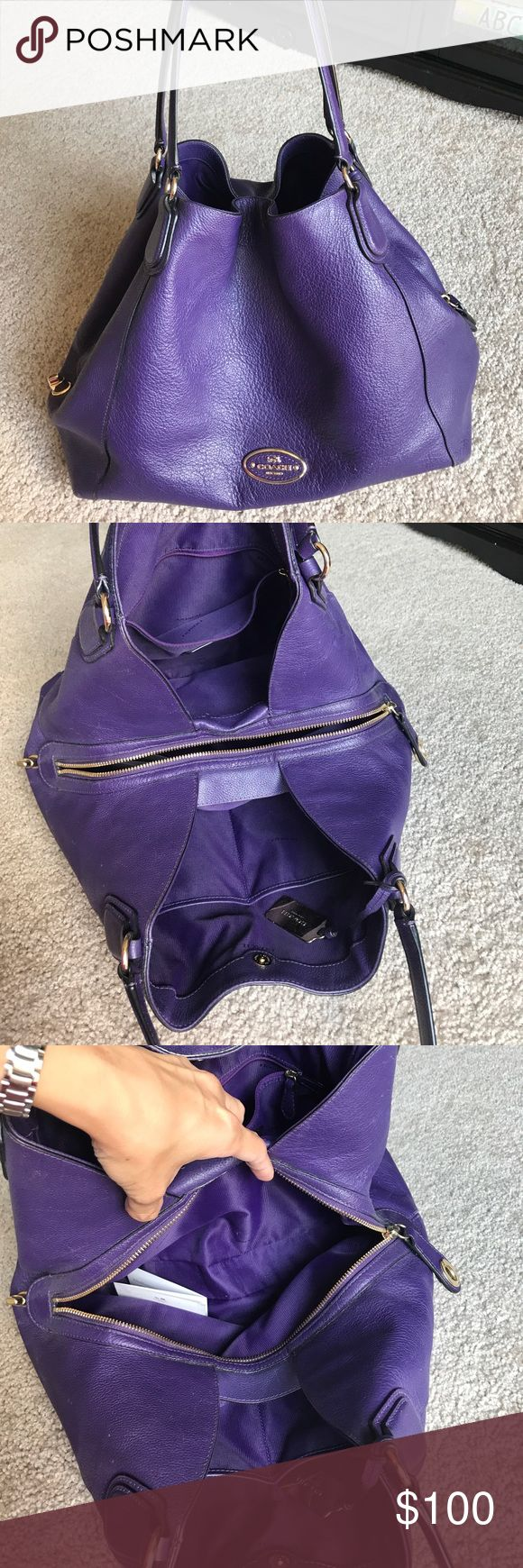 Purple coach purse Well used but fairly clean coach purse. Bought from coach store but received as gift so no receipts. Lots of pockets and a lock for center zip pocket. Coach Bags Shoulder Bags