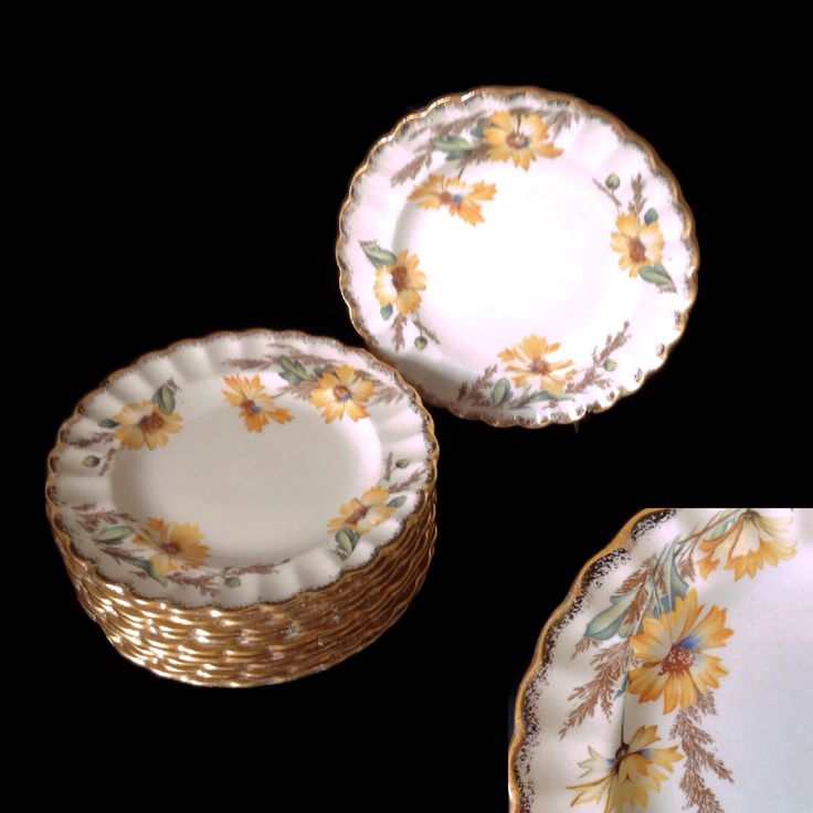 Vintage 1940's Limoges China Bread and Butter Plates Yellow Daisy Fluted 22K Gold Trim Set of 11 Spring Colors Beautiful Condition by MerrilyVerilyVintage on Etsy https://www.etsy.com/listing/475099103/vintage-1940s-limoges-china-bread-and
