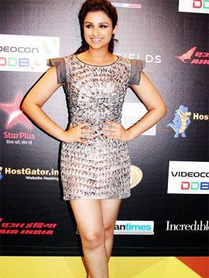 Parineeti Chopra is seen In a short shimmery silver dress, Parineeti looks pretty neat for an even as big as the IIFA.