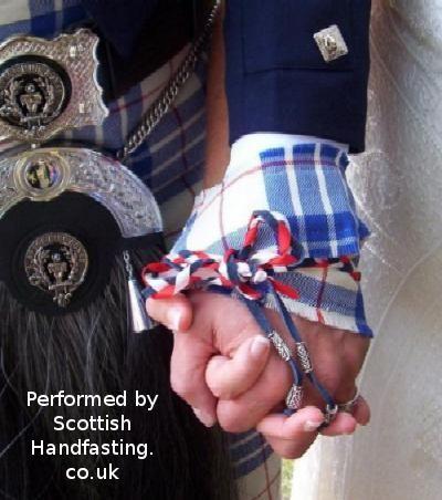 Handfasting  at a wedding. Copyright.