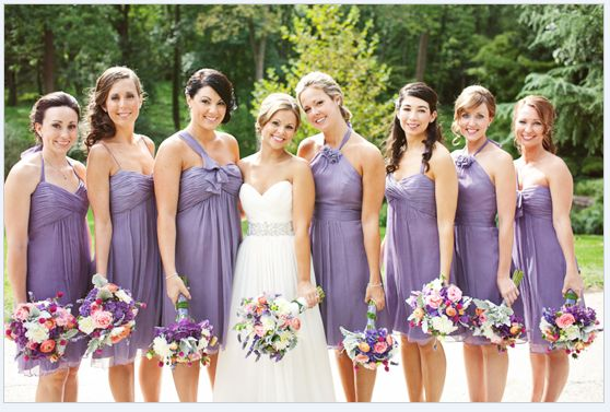 Perfect example of mismatched-coordinated wisteria/dusty lavender bridesmaid gowns