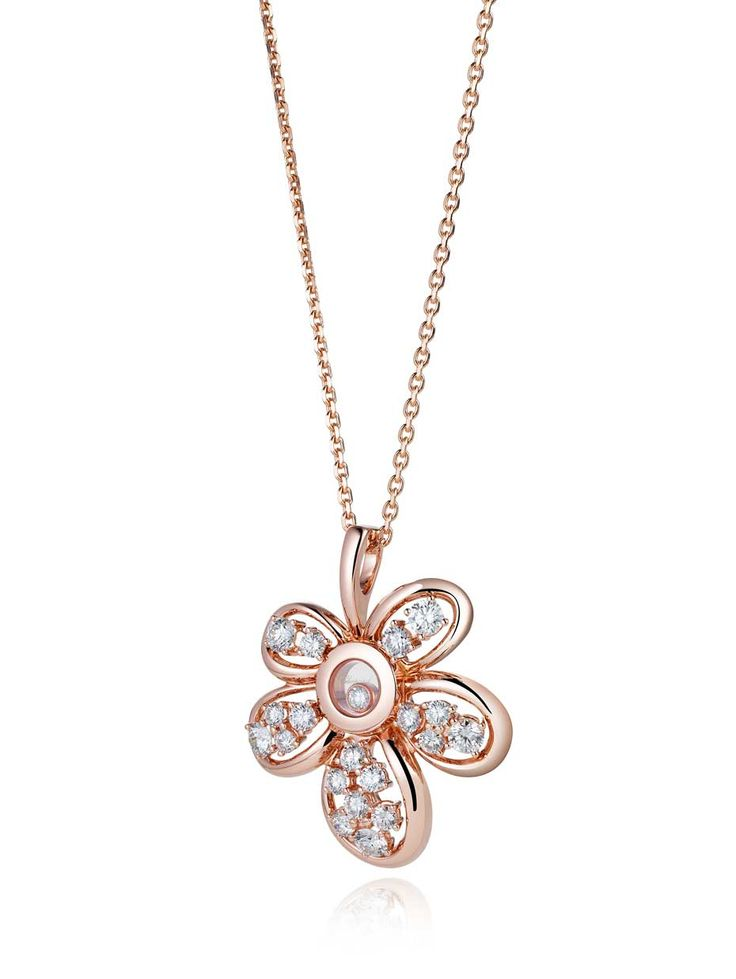 Chopard floral diamond necklace in rose gold, set with a floating diamond in the centre surrounded by 19 diamonds, new to the the Happy Diamonds collection.