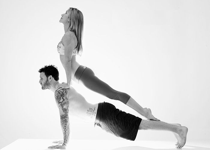 Couples Yoga....I'd like to try this at least once. I think we would have a great time with some good laughs!