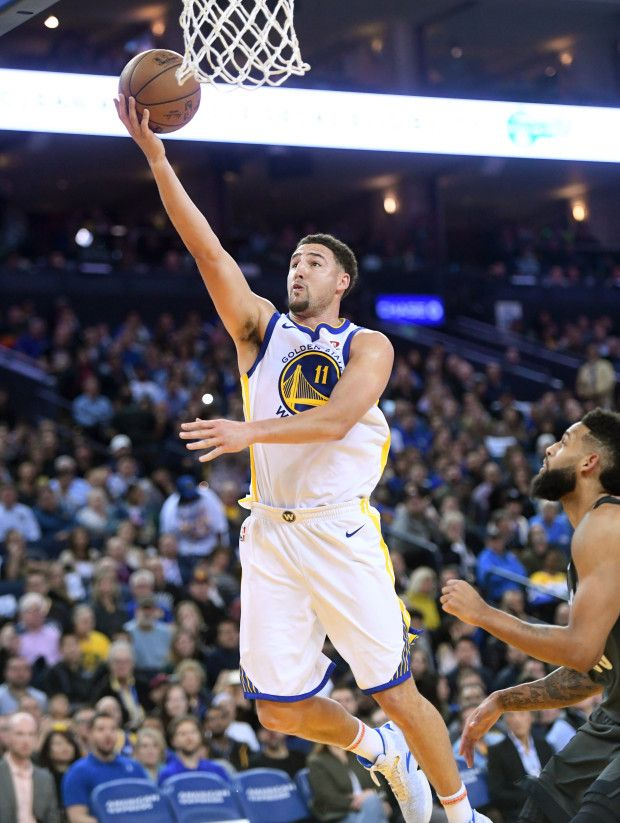 Golden State Warriors Klay Thompson 11 Makes A Layup In The Fourth Period Of Their Nba Game Agains Klay Thompson Golden State Warriors Basketball Basketball