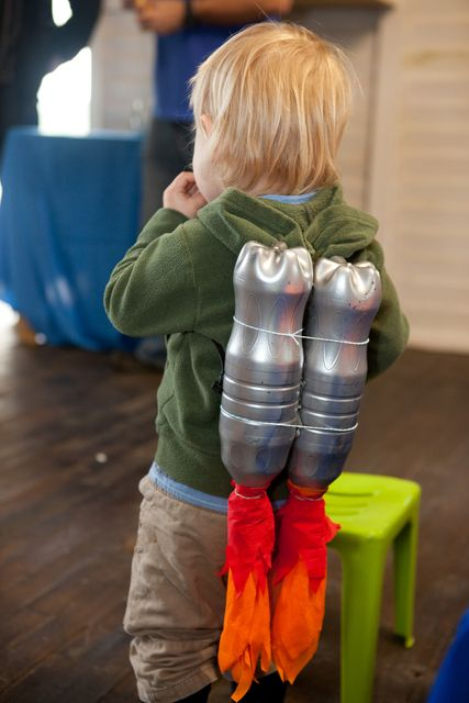 Jet Pack (Catch My Party): Cute idea for the birthday boy or other party guests; make a jet pack out of spray-painted bottles and red and orange tissue paper or fabric. Great for an outer space birthday party, astronaut party, alien theme, rocket party, and more!