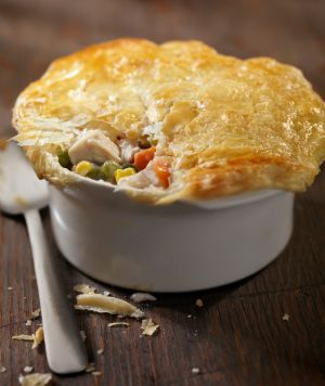 """Dr. Oz's Chicken Pot Pie / Enjoy a lighter version of this comfort food favorite without compromising the savory taste. This recipe calls for a """"drop"""" biscuit dough that adds density to the topping, so you'll get all the flaky goodness of a traditional piecrust without the fat and calories of butter! For an extra kick, add a few handfuls of grated sharp cheddar cheese to the dough before rolling."""