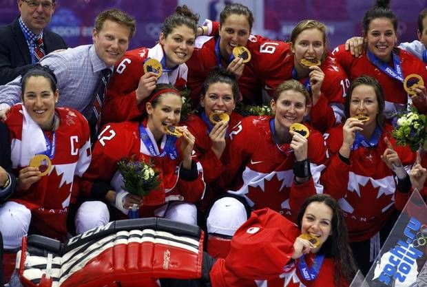 Team Canada players and staff pose with their gold medals during the presentation ceremony after Canada defeated Team USA in overtime in the women's ice hockey final game at the 2014 Sochi Winter Olympics, February 20, 2014. (BRIAN SNYDER/REUTERS)