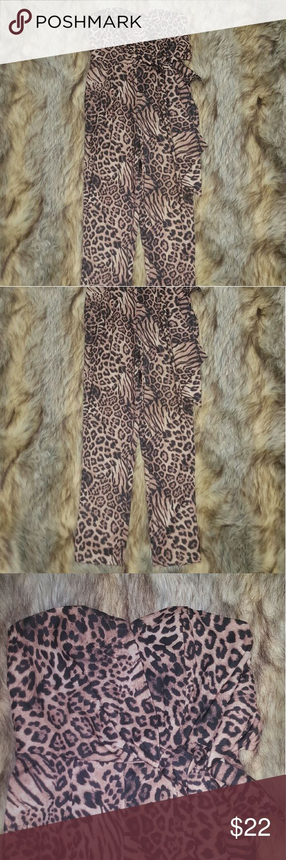 NWT $42 Mustard Seed Sz S Animal Print Jump Suit New with tags $42 Mustard Seed Sz S animal print jumpsuit, zip back, wrap tie under bust area, built in boning in bust. Mustard Seed Pants Jumpsuits & Rompers