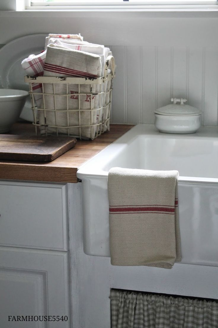 beadboard backsplash // more inexpensive and less time consuming option than subway tile. I also like the wire basket for kitchen towels.
