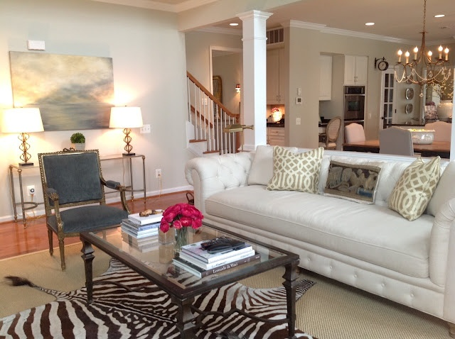 We can't resist the zebra rug, linked table lamps and fun trellis pillows.