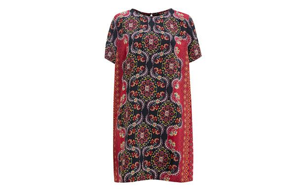 """Printed Tunic. """"Dressed up or down, the vibrant folkloric print of this tunic looks great with ankle boots and opaque tights."""""""