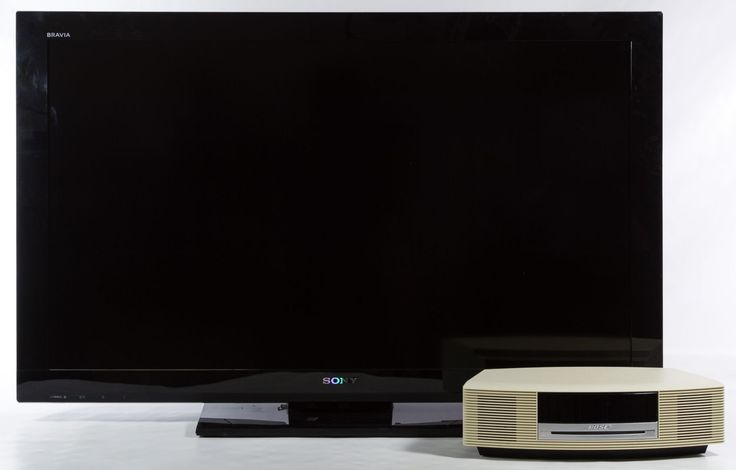Lot 492: Sony Bravia Flat Screen TV and Bose Wave Music System; Sony model No.KDL-40BX421 and serial No.3024069, forty-inch screen, includes remote and instructions; Bose model No.AWRCC2 and serial No.033976C43045765AC, includes remote