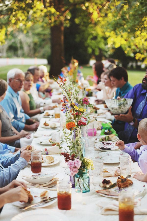 Southern weddings - family style meal, long table, wildflowers, mismatched china :)