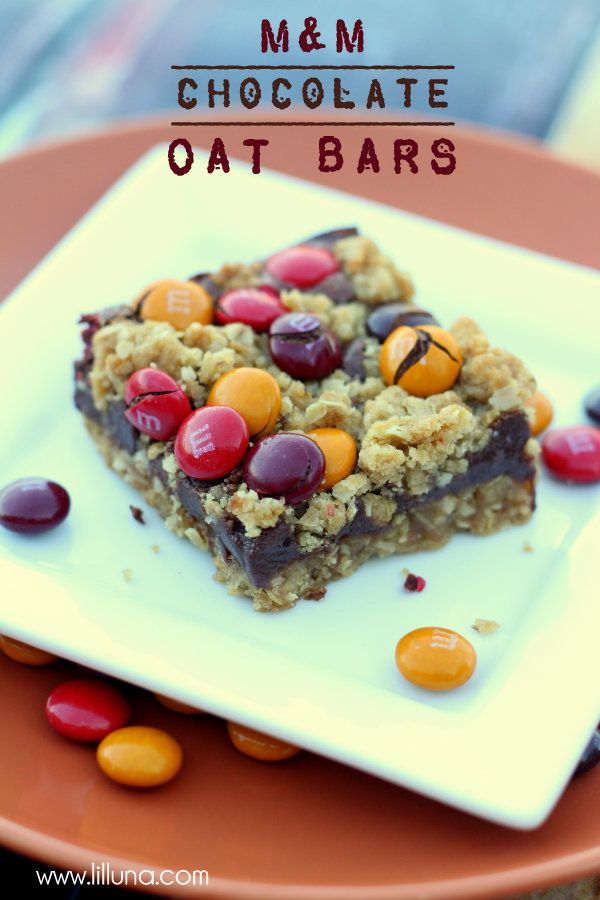 Fall M&M Chocolate Oat Bars. INGREDIENTS: 1 1/2 cups quick oats 1 1/2 cups flour 1 cup brown sugar 1 tsp. salt 1 cup butter melted 1 14 oz. can sweetened condensed milk 1 bag milk chocolate chips 2 TB butter softened 1 cup M&Ms