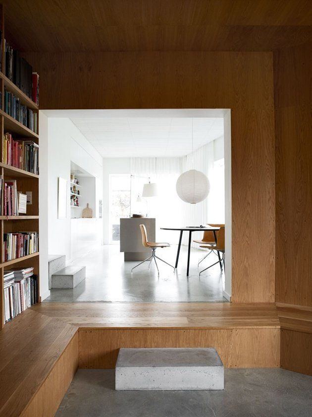 Villa Weinberg, Aarhus, Denmark, wood lined den, concrete sleepers as steps into kitchen, concrete floors, Noguchi Akari Pendant | Remodelis...