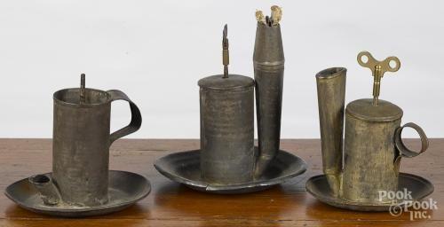 Three tin lard lamps, 19th c., with a key wound push rod, 7 1/4'' h.