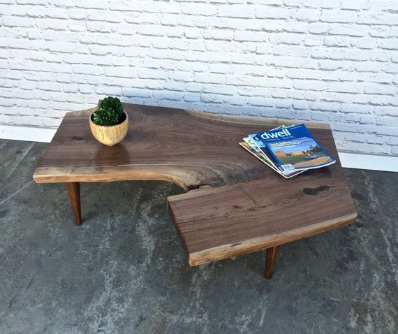 To see our current inventory of live edge coffee tables please visit our In Stock Section from the link below  https://www.etsy.com/shop/STORnewyork?ref=hdr_shop_menu&section_id=19946217 In Stock! Ready to ship!  Free delivery in NYC!!!  Beautiful and stylish coffee table inspired by George Nakashimas style  Handmade in New York supporting local businesses and fair labor.  Size is 46 L x 14 H x 35 W (at its widest point)  Not exactly what you are looking for?...