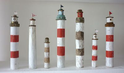 Wonderful Light houses by Kirsty Elson, I have one of these beauties on my mantlepiece, but a row of them like this wouldn't go a miss.