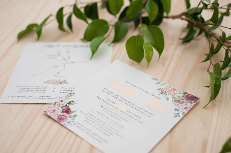 Copper foiling accents this floral adorned wedding invitation