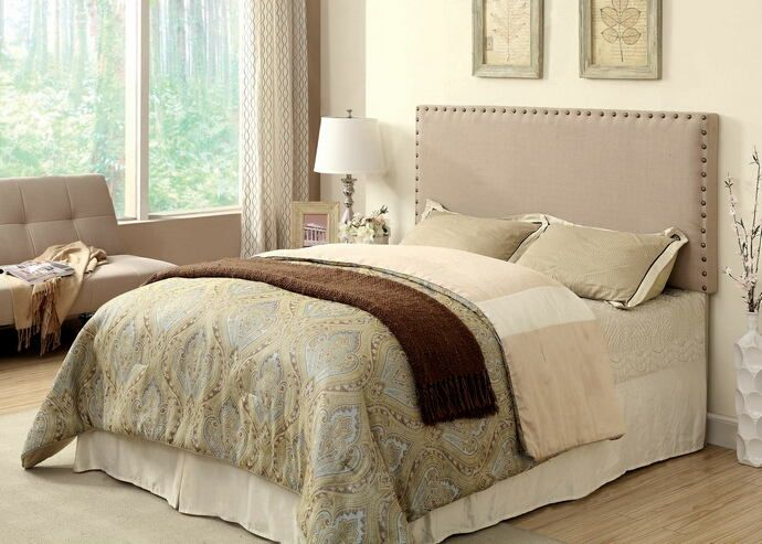 """Herstal collection ivory linen like fabric rectangular padded Full / Queen size headboard with nail head trim.  This headboard is upholstered in a faux linen like fabric with padded and nail head trim .  This Headboard measures: 63 1/2"""" W x 3/34"""" D x 42 1/2"""" - 52"""" H. Some Assembly May Be Required."""