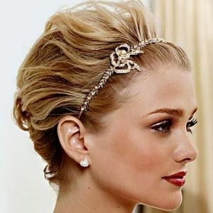 I'm looking for a way to do my short hair for my cousins wedding that is Audrey reminiscent.  I like this one.