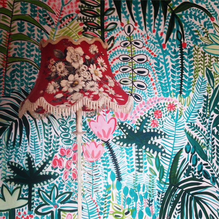 Hand painted tropical floral mural by Lucy Tiffney