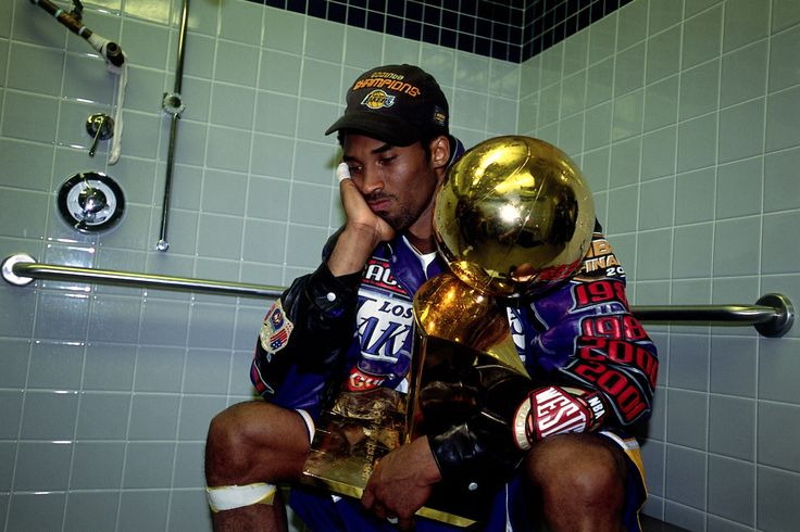 PHILADELPHIA - JUNE 15: Kobe Bryant #8 of the Los Angeles Lakers poses with the NBA Championship trophy after defeating the Philadelphia 76ers in game five of the 2001 NBA Finals at First Union Center on June 15, 2001 in Philadelphia, Pennsylvania....