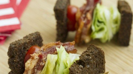 This BLT-on-a-stick appetizer made with rye bread, bacon, lettuce, and tomato is a crowd-pleasing party food.