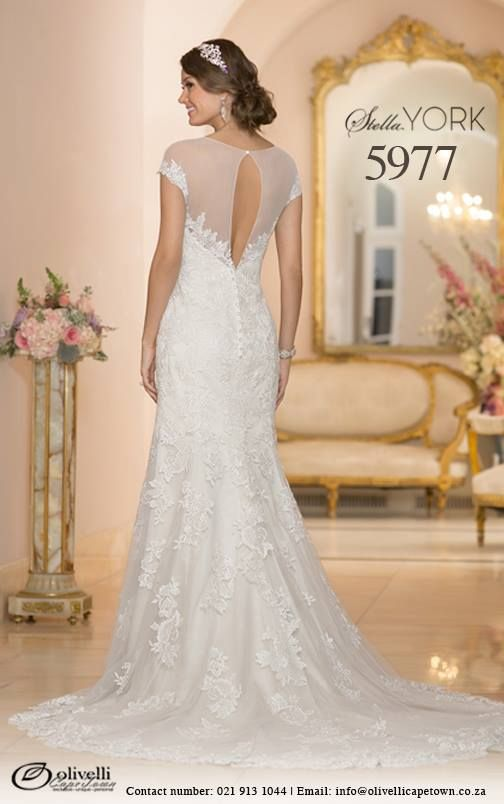 Stella York, style 5977 is a vintage inspired wedding gown. Say your vows in this breath-taking Lace over Lavish Satin sheath gown. The attention to detail on this dress, like a whispery-soft illusion neckline and the elegant keyhole back will blow your mind.  #StellaYork #OlivelliCT #Wedding #Gown #Dress